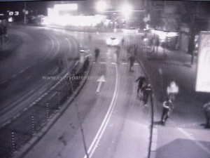 A freeze frame from the traffic recording that shows Andrei Monov's friends in pursuit of someone.